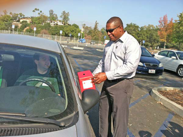 ABC7 Eyewitness News reporter Leo Stallworth collects a donation from a viewer at our Sandy relief drive at the Rose Bowl in Pasadena on Friday, Nov. 2, 2012.