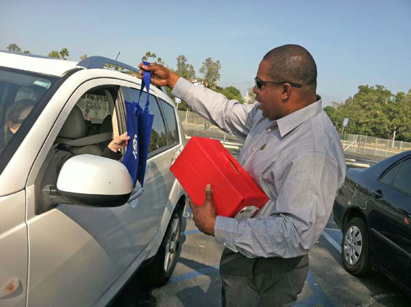 ABC7 Eyewitness News reporter Leo Stallworth collects a donation from a viewer at our Sandy relief drive at the Rose Bowl in Pasadena on Friday, Nov. 2, 2012. <span class=meta>(KABC)</span>