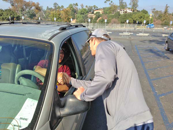ABC7 Eyewitness News anchor Phillip Palmer collects a donation from a viewer at our Sandy relief drive at the Rose Bowl in Pasadena on Friday, Nov. 2, 2012. <span class=meta>(KABC)</span>