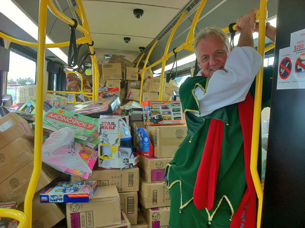 Bus #2 is stuffed! ABC7&#39;s Garth Kemp is happy to see the second bus of day stuffed with toys at the Stuff-A-Bus event at Mathis Brothers Furniture in Ontario on Friday, Nov. 30, 2012.  <span class=meta>(KABC)</span>