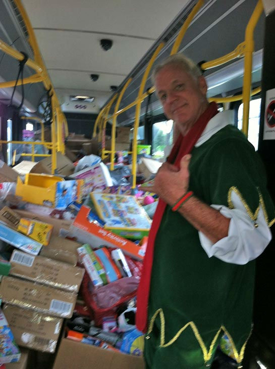 Bus #4 stuffed! Garth the Elf gives a thumbs up to the fourth bus stuffed at the Stuff-A-Bus toy drive at Mathis Brothers Furniture in Ontario on Friday, Nov. 30, 2012. <span class=meta>(KABC)</span>