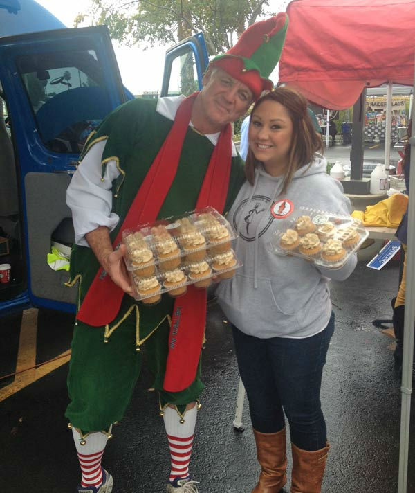 "<div class=""meta image-caption""><div class=""origin-logo origin-image ""><span></span></div><span class=""caption-text"">[Desi]gn Cakes and Cupcakes brought Garth the Elf and volunteers some yummy cupcakes to snack on at the Stuff-A-Bus toy drive at Mathis Brothers Furniture in Ontario on Friday, Nov. 30, 2012. (KABC)</span></div>"