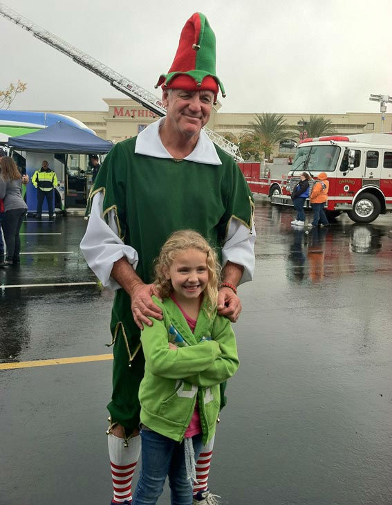 "<div class=""meta image-caption""><div class=""origin-logo origin-image ""><span></span></div><span class=""caption-text"">Garth the Elf poses with a young ABC7 viewer at the Stuff-A-Bus toy drive at Mathis Brothers Furniture in Ontario on Friday, Nov. 30, 2012. (KABC)</span></div>"