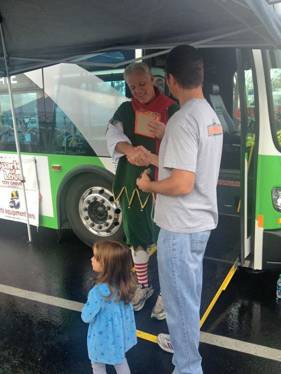 "<div class=""meta ""><span class=""caption-text "">ABC7's Garth Kemp takes a toy donation at the Stuff-A-Bus event at Mathis Brothers Furniture in Ontario on Friday, Nov. 30, 2012. (KABC)</span></div>"