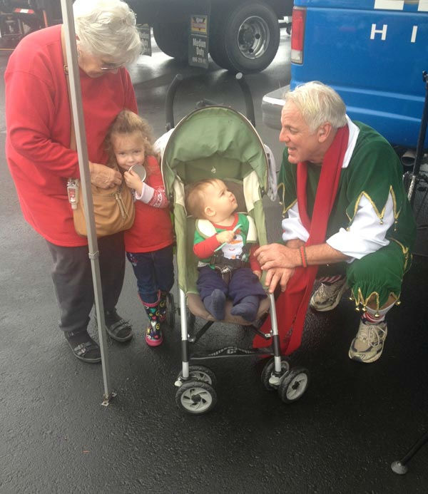 Garth the Elf poses with ABC7 viewers at the Stuff-A-Bus toy drive at Mathis Brothers Furniture in Ontario on Friday, Nov. 30, 2012.