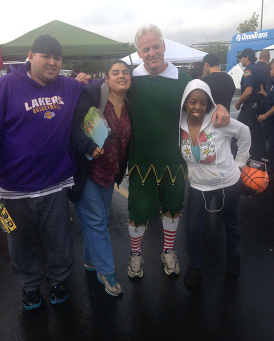 Garth the Elf poses with viewers at the Stuff-A-Bus event at Mathis Brothers Furniture in Ontario on Friday, Nov. 30, 2012.
