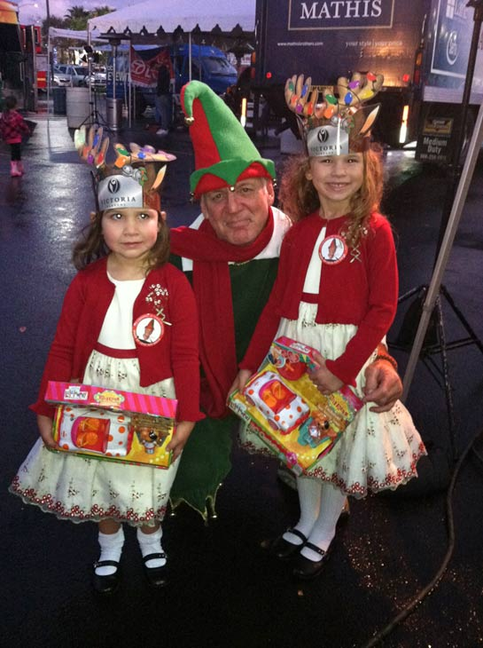Garth the Elf poses with two young princesses at the Stuff-A-Bus toy drive at Mathis Brothers Furniture in Ontario on Friday, Nov. 30, 2012. <span class=meta>(KABC)</span>