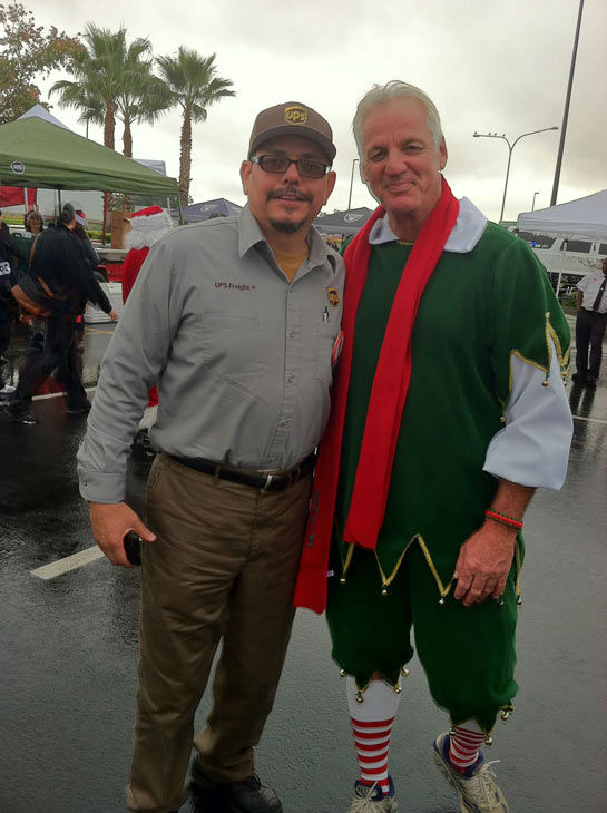 Garth the Elf poses with a viewer at the Stuff-A-Bus event at Mathis Brothers Furniture in Ontario on Friday, Nov. 30, 2012. <span class=meta>(KABC)</span>