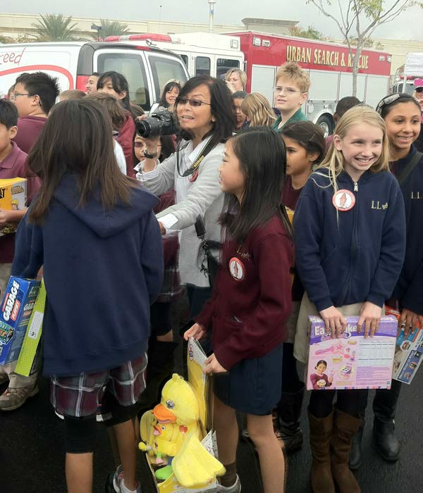 Students from Loma Linda Academy join ABC7 at the Stuff-A-Bus toy drive at Mathis Brothers Furniture in Ontario on Friday, Nov. 30, 2012.  <span class=meta>(KABC)</span>