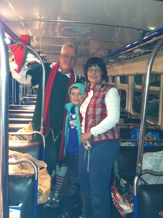 Garth the Elf poses with toy donors at the Stuff-A-Bus toy drive at Mathis Brothers Furniture in Ontario on Friday, Nov. 30, 2012.