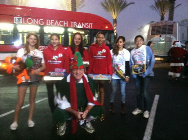 Los Alamitos High Cross County team and Garth the Elf pose for a picture at the Stuff-A-Bus toy drive at Los Cerritos Center in Cerritos on Friday, Dec. 7, 2012. <span class=meta>(KABC Photo)</span>