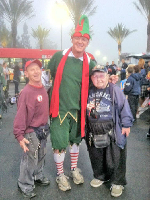 Brenda and Dennis of Long Beach and Garth the Elf at the Stuff-A-Bus toy drive at Los Cerritos Center in Cerritos on Friday, Dec. 7, 2012. <span class=meta>(KABC Photo)</span>