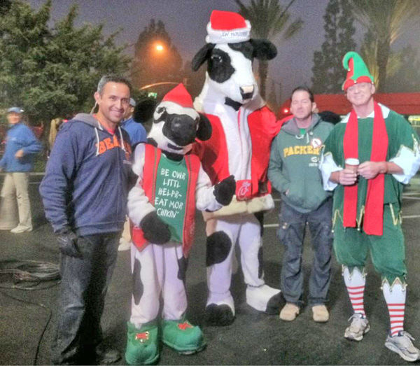 Chick-Fil-A cows showed a little love and posed for a picture with Garth the Elf at the Stuff-A-Bus toy drive at Los Cerritos Center in Cerritos on Friday, Dec. 7, 2012. <span class=meta>(KABC Photo)</span>