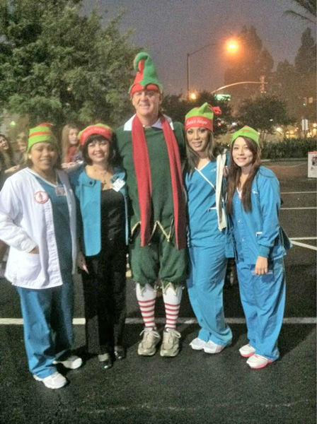Pioneer Medical Group came out to support Garth the Elf at the Stuff-A-Bus toy drive at Los Cerritos Center in Cerritos on Friday, Dec. 7, 2012. <span class=meta>(KABC Photo)</span>