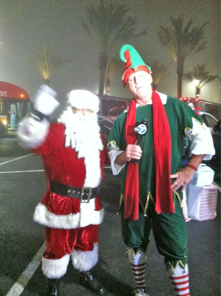 Santa stopped by with blessings and to pose for a picture with Garth the Elf at the Stuff-A-Bus toy drive at Los Cerritos Center in Cerritos on Friday, Dec. 7, 2012. <span class=meta>(KABC Photo)</span>