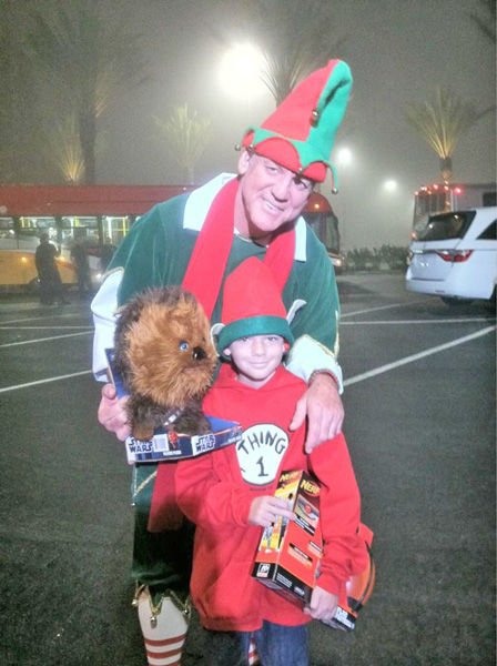 Garth the Elf and an ABC7 viewer in the holiday spirit at the Stuff-A-Bus toy drive at Los Cerritos Center in Cerritos on Friday, Dec. 7, 2012. <span class=meta>(KABC Photo)</span>