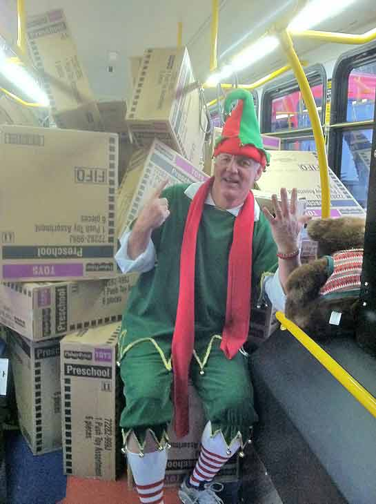 Garth the Elf takes a break in bus No. 6 during the Stuff-A-Bus toy drive at Los Cerritos Center in Cerritos on Friday, Dec. 7, 2012. <span class=meta>(KABC Photo)</span>