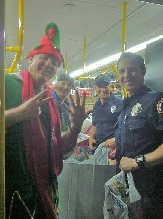 "<div class=""meta ""><span class=""caption-text "">Garth the Elf and his little helpers are seen inside stuffed bus No. 7 during the Stuff-A-Bus toy drive at Los Cerritos Center in Cerritos on Friday, Dec. 7, 2012. (KABC Photo)</span></div>"