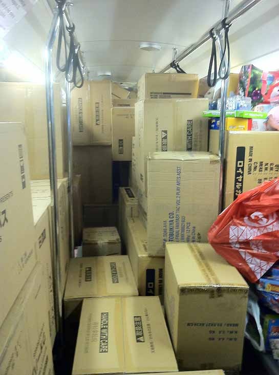 "<div class=""meta image-caption""><div class=""origin-logo origin-image ""><span></span></div><span class=""caption-text"">Boxes crowd bus No. 8! Donors in Cerritos stuffed a record eight buses during Stuff-A-Bus at the Los Cerritos Center on Friday, Dec. 7, 2012. (KABC Photo)</span></div>"