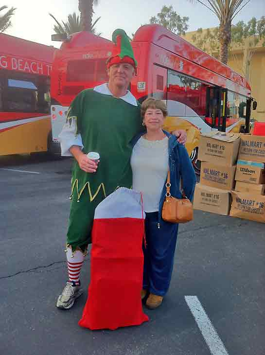 Florie Lindsay brought a sack full of toys to Garth the Elf for ABC7&#39;s Stuff-A-Bus toy drive at Los Cerritos Center in Cerritos on Friday, Dec. 7, 2012. <span class=meta>(KABC Photo)</span>