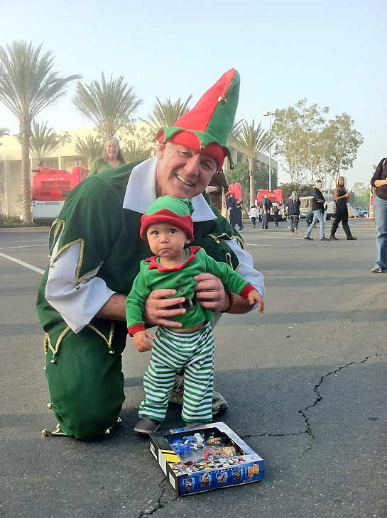 Garth the Elf got a special visit from a fellow elf during the Stuff-A-Bus toy drive at Los Cerritos Center in Cerritos on Friday, Dec. 7, 2012. <span class=meta>(KABC Photo)</span>