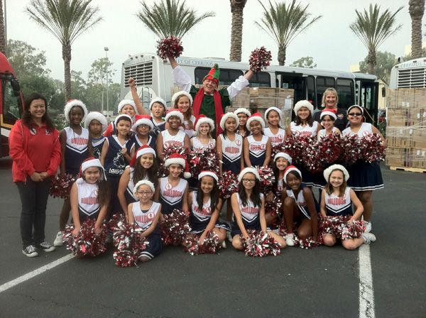 "<div class=""meta ""><span class=""caption-text "">Garth the Elf and Burbank Elementary cheerleaders at the Stuff-A-Bus toy drive at Los Cerritos Center in Cerritos on Friday, Dec. 7, 2012.   (KABC Photo)</span></div>"