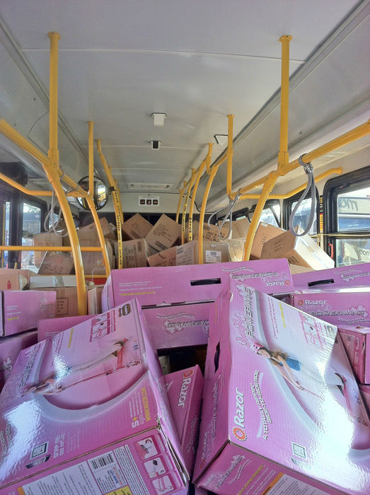 Bus #4 stuffed! The fourth bus was packed full of Razor scooters at the Stuff-A-Bus toy drive at Los Cerritos Center in Cerritos on Friday, Dec. 7, 2012. <span class=meta>(KABC Photo)</span>