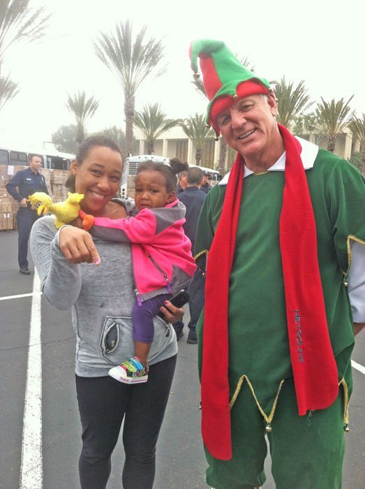 Garth the Elf and adorably generous donors at the Stuff-A-Bus toy drive at Los Cerritos Center in Cerritos on Friday, Dec. 7, 2012. <span class=meta>(KABC Photo)</span>