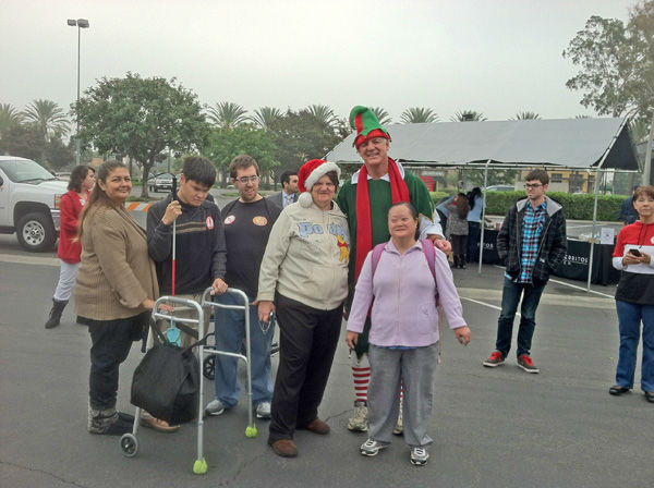 "<div class=""meta ""><span class=""caption-text "">Garth the Elf and Norwalk Easter Seals at the Stuff-A-Bus toy drive at Los Cerritos Center in Cerritos on Friday, Dec. 7, 2012. (KABC Photo)</span></div>"