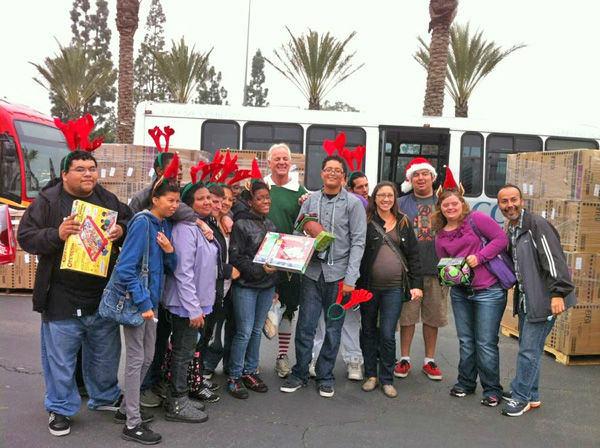 Garth the Elf and generous donors from the Huerta adult transition program in Norwalk at the Stuff-A-Bus toy drive at Los Cerritos Center in Cerritos on Friday, Dec. 7, 2012. <span class=meta>(KABC Photo)</span>