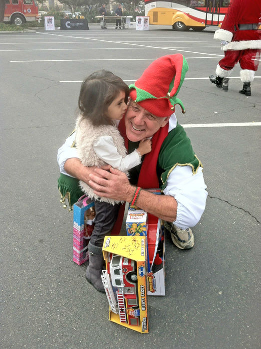 Garth the Elf got a big kiss from a generous donor from Bellflower at the Stuff-A-Bus toy drive at Los Cerritos Center in Cerritos on Friday, Dec. 7, 2012. <span class=meta>(KABC Photo)</span>