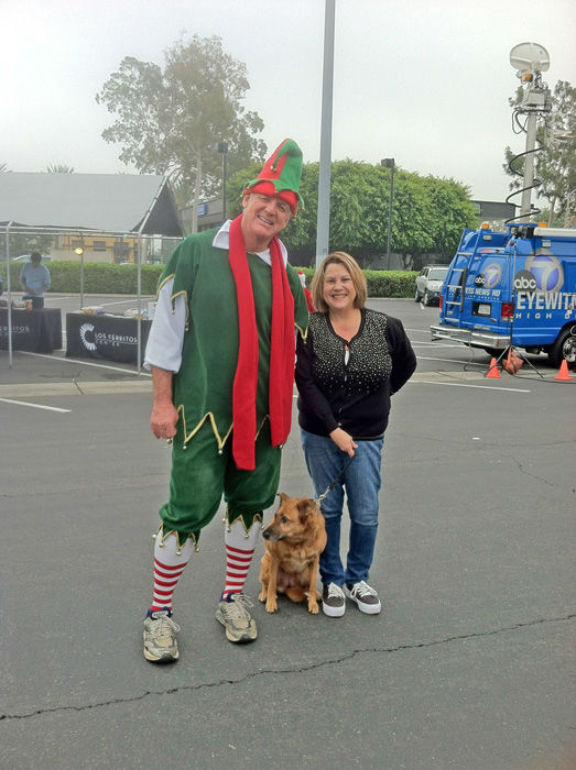 A generous donor and her beautiful dog Sadie came out to support Garth the Elf at the Stuff-A-Bus toy drive at Los Cerritos Center in Cerritos on Friday, Dec. 7, 2012. <span class=meta>(KABC Photo)</span>