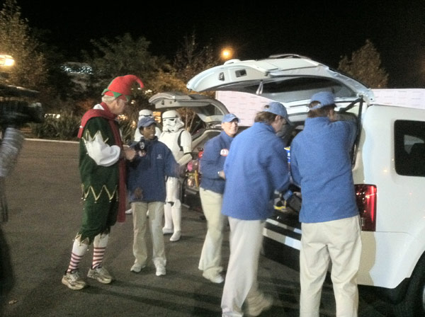 SoCal Honda representatives help unload cars full of toys at the Stuff-A-Bus toy drive at the Westfield Topanga mall at Canoga Park on Friday, Dec. 14, 2012. <span class=meta>(KABC Photo)</span>