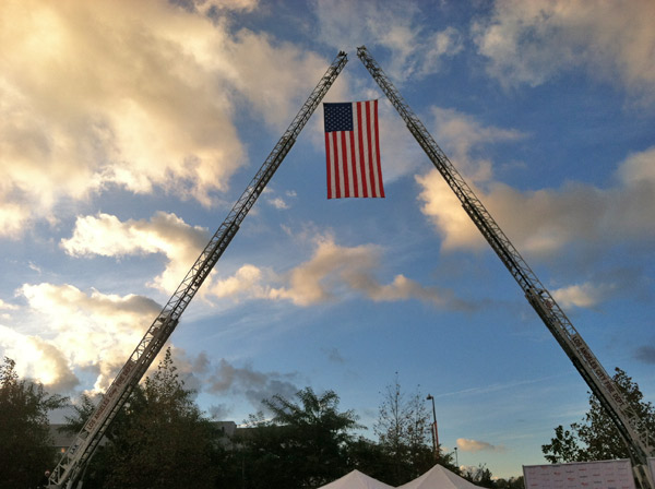 The Los Angeles City Fire Department set up an American flag at the Stuff-A-Bus toy drive event at the Westfield Topanga mall at Canoga Park on Friday, Dec. 14, 2012. <span class=meta>(KABC Photo)</span>