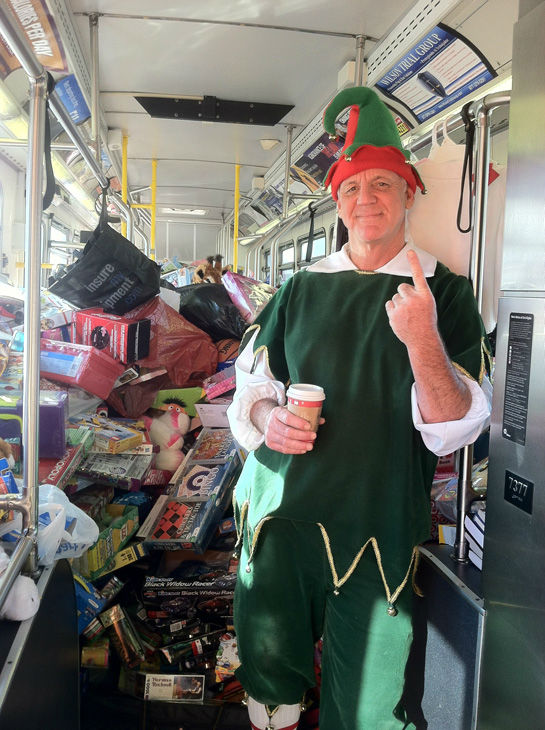Garth the Elf is seen inside the first bus stuffed at Stuff-A-Bus toy drive at the Westfield Topanga mall at Canoga Park on Friday, Dec. 14, 2012. <span class=meta>(KABC Photo)</span>