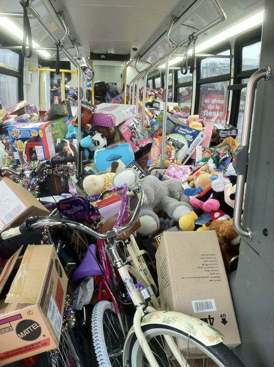 "<div class=""meta ""><span class=""caption-text "">The third bus is stuffed with toys at Stuff-A-Bus toy drive at the Westfield Topanga mall at Canoga Park on Friday, Dec. 14, 2012. (KABC Photo)</span></div>"