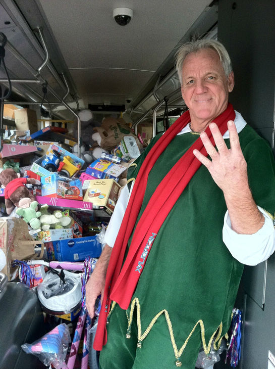 Garth the Elf is seen inside the fourth stuffed bus at Stuff-A-Bus toy drive at the Westfield Topanga mall at Canoga Park on Friday, Dec. 14, 2012. <span class=meta>(KABC Photo)</span>