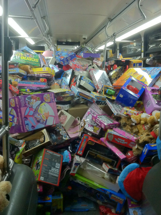 "<div class=""meta ""><span class=""caption-text "">The fifth bus is seen stuffed at the Stuff-A-Bus toy drive at the Westfield Topanga mall at Canoga Park on Friday, Dec. 14, 2012. (KABC Photo)</span></div>"