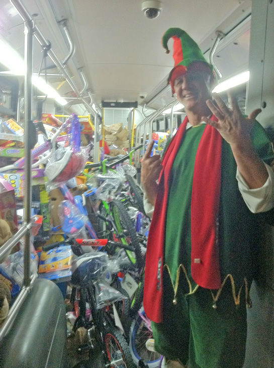 Garth the Elf is seen inside the sixth stuffed bus at the Stuff-A-Bus toy drive at the Westfield Topanga mall at Canoga Park on Friday, Dec. 14, 2012. <span class=meta>(KABC Photo)</span>