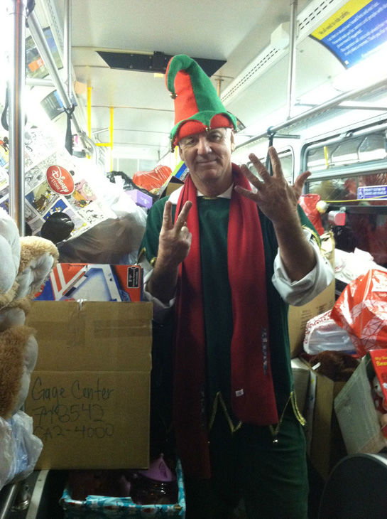 Garth the Elf is seen inside the seventh stuffed bus at the Stuff-A-Bus toy drive at the Westfield Topanga mall at Canoga Park on Friday, Dec. 14, 2012. <span class=meta>(KABC Photo)</span>