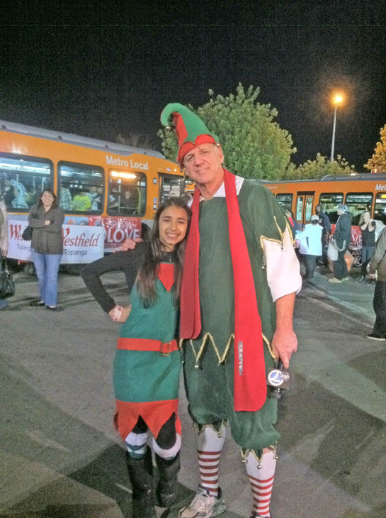 An elf stops by support fellow elf Garth at the Stuff-A-Bus toy drive at the Westfield Topanga mall at Canoga Park on Friday, Dec. 14, 2012. <span class=meta>(KABC Photo)</span>