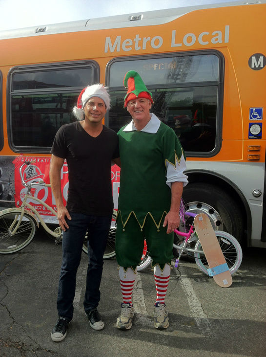 Joe Francis and Garth the Elf pose for a picture at the Stuff-A-Bus toy drive at the Westfield Topanga mall at Canoga Park on Friday, Dec. 14, 2012. <span class=meta>(KABC Photo)</span>