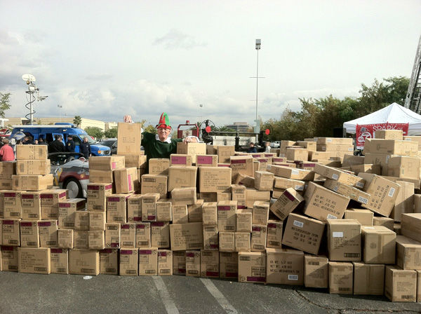 Garth the Elf is seen hidden behind boxes of toys as the Stuff-A-Bus toy drive at the Westfield Topanga mall at Canoga Park on Friday, Dec. 14, 2012. <span class=meta>(KABC Photo)</span>