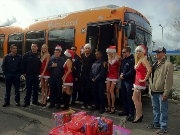 "<div class=""meta ""><span class=""caption-text "">Joe Francis and his crew show up dressed in festive attire to support Garth the Elf at the Stuff-A-Bus toy drive at the Westfield Topanga mall at Canoga Park on Friday, Dec. 14, 2012. (KABC Photo)</span></div>"