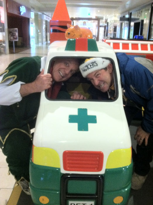 Garth the Elf poses in a toy ambulance at the Stuff-A-Bus toy drive at the Westfield Topanga mall at Canoga Park on Friday, Dec. 14, 2012. <span class=meta>(KABC Photo)</span>