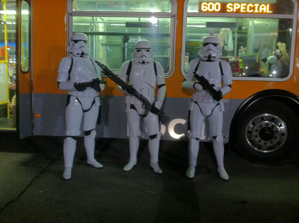 Volunteers dressed as Storm Troopers pose in front of a bus at the Stuff-A-Bus toy drive at the Westfield Topanga mall at Canoga Park on Friday, Dec. 14, 2012. <span class=meta>(KABC Photo)</span>