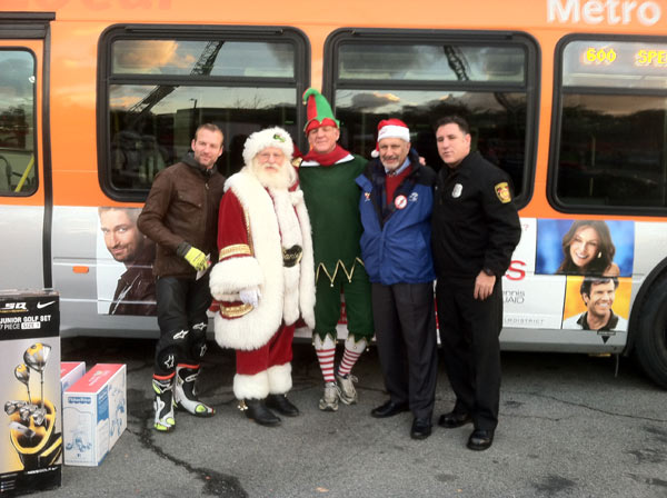 Garth the Elf poses with actor Gunner Wright, Los Angeles City Councilman Dennis Zine and Santa Claus at the Westfield Topanga mall at Canoga Park on Friday, Dec. 14, 2012. <span class=meta>(KABC Photo)</span>