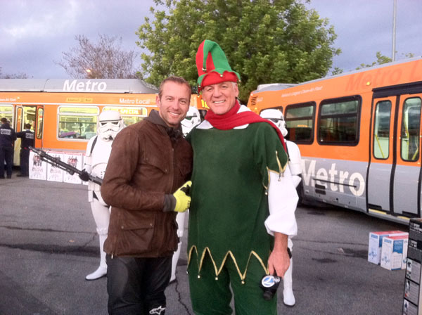 Actor Gunner Wright poses with Garth the Elf at the Stuff-A-Bus toy drive event at the Westfield Topanga mall at Canoga Park on Friday, Dec. 14, 2012. <span class=meta>(KABC Photo)</span>