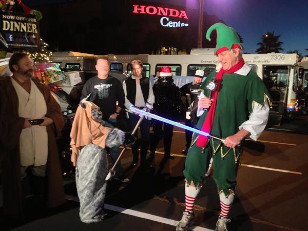 "<div class=""meta ""><span class=""caption-text "">Garth the Elf and an Ewok are seen at the Stuff-A-Bus toy drive at the Honda Center in Anaheim on Friday, Dec. 21, 2012. (KABC Photo)</span></div>"