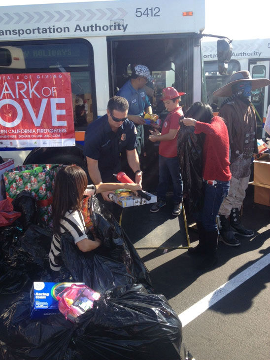 Generous donors came out to support the Stuff-A-Bus toy drive at the Honda Center in Anaheim on Friday, Dec. 21, 2012. <span class=meta>(KABC Photo)</span>